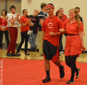 Homecoming court seniors Jack Garabedian and Grace DeMember walk out to participate in one of the competitions