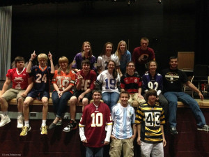 Students in marching band sport their favorite team's jersey.