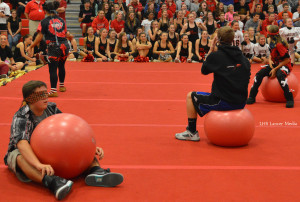 """Members of the Homecoming court participate in """"musical balls"""", a play on the game musical chairs. All competitors were blindfolded."""
