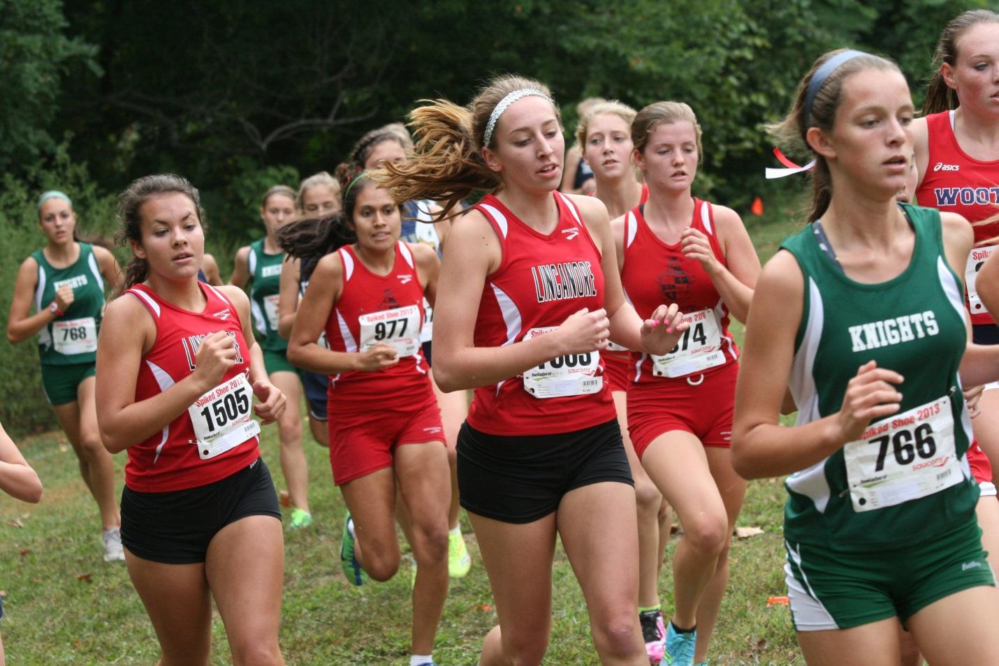 Juniors Abby Lyons (left) and Sydney Garwood (right) compete in the Johns Hopkins race September 21. Photo courtesy of Luke Garwood.
