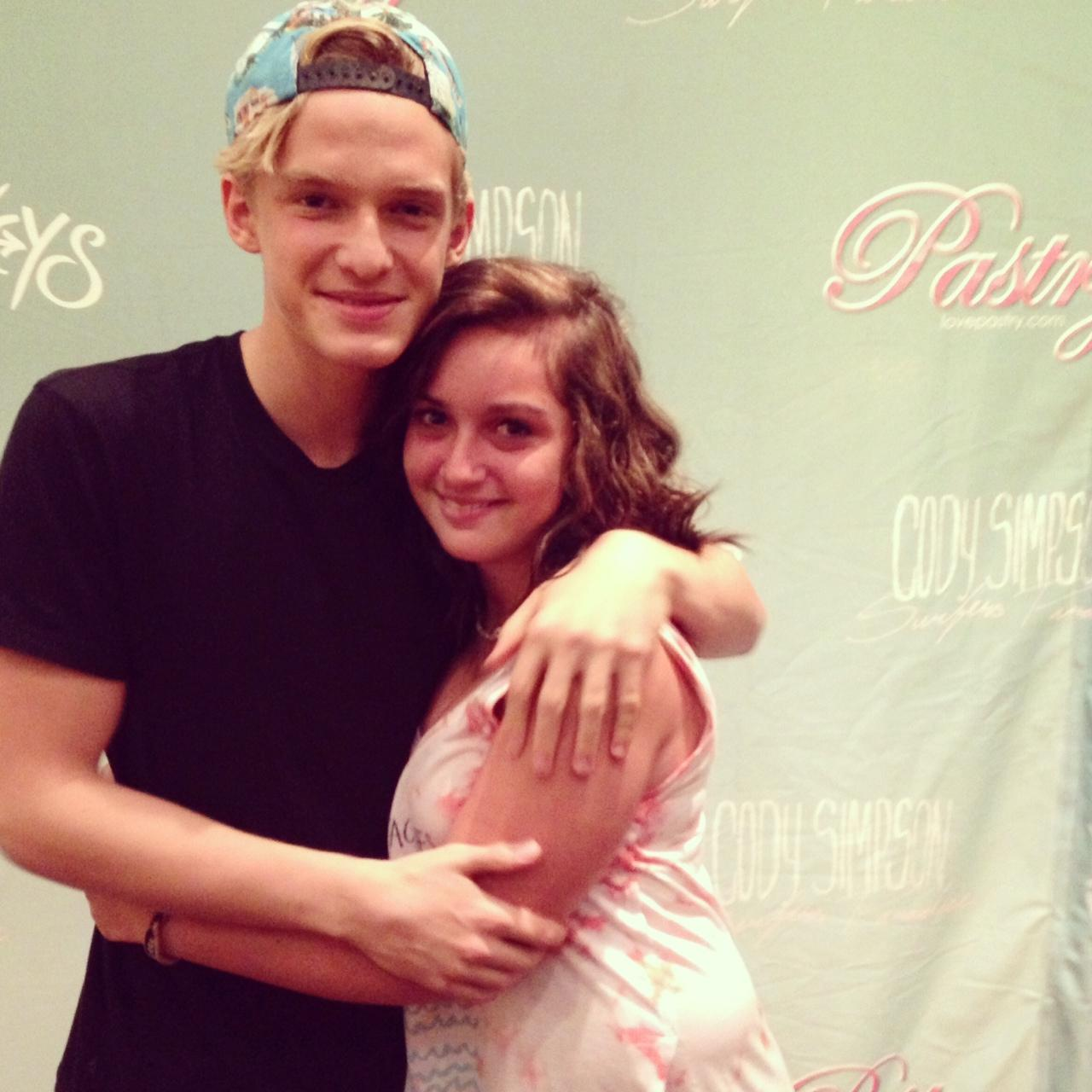 Cody Simpson and Kate Mannarino at a meet and greet in D.C. on August 3, 2013