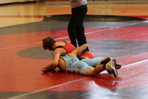 Photo of the Day 1/27/14: Yinger wrestles against Westminster