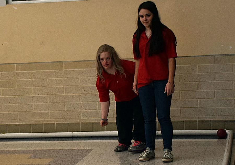 Michelle+Weddle+%28right%29+helps+Sarah+Webber+%28left%29+throw+the+bocce+ball+at+their+match+against+Oakdale.+
