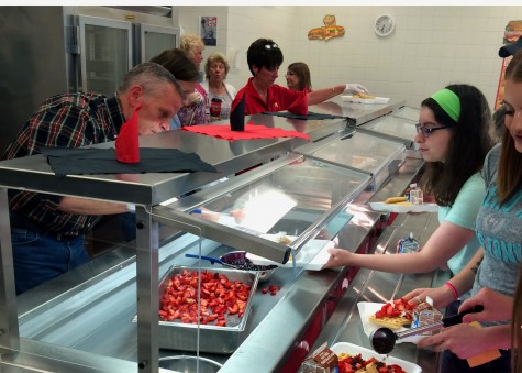 Alumni association serves a waffle breakfast before graduation rehearsals: Photo of the day 5/29/2015