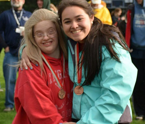 Sarah Webber (left) and Michelle Weddle (right) pose after their bronze medal victory at the Unified Track District Tournament.