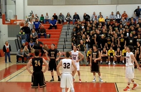 Boys varsity basketball season tip-off is a win: Photo of the Day 12/4/15
