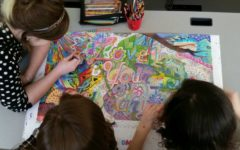 Students add the finishing touches to the media center's coloring poster: Photo of the Day 11/28/16