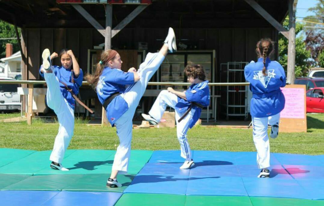 Hanna Dufresne (second one from the left) performs with her Tae Kwon Do demo team.
