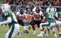 Jackson Ambush plows through the football field
