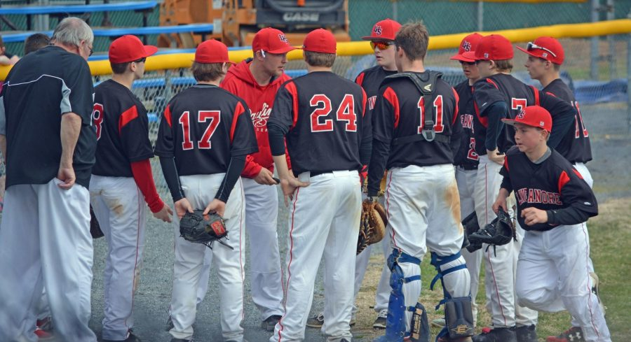 The+Lancer+JV+baseball+team+huddles+together+during+Tuesday%27s+game+against+Walkersville.