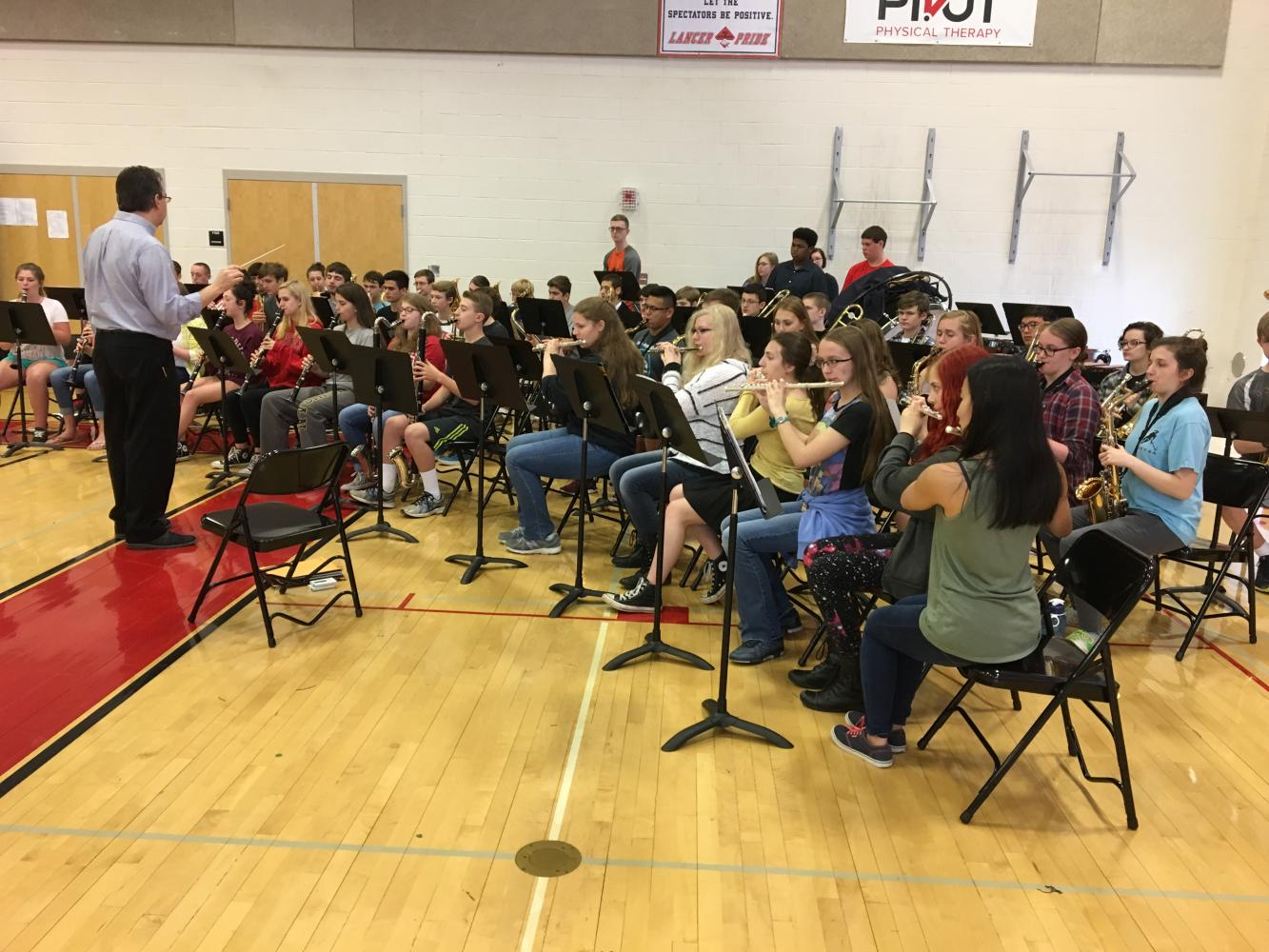 The LHS band, led by Kevin Lloyd, plays during the class of 2017's second graduation practice.