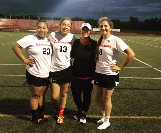 (Left to Right) Bre Wade, Grace Weaver, Coach Jackie Sowers, Emily Daly