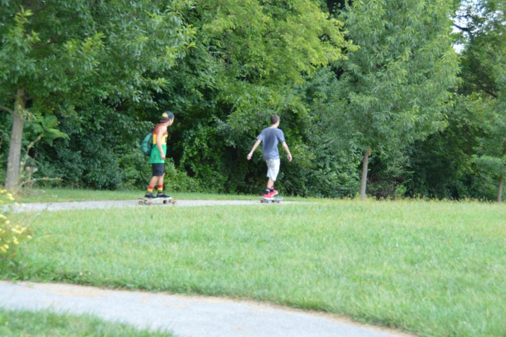 Junior+Kobi+Azoulay+%28left%29+and+Sophomore+Justin+Mitchell+%28right%29+longboard+down+a+hill