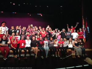 Band class wearing red, black, and bows.