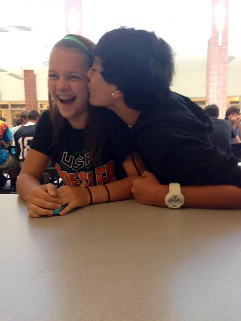 Junior Chaz Atchison kissing sophomore Maggie Hall's cheek at lunch.