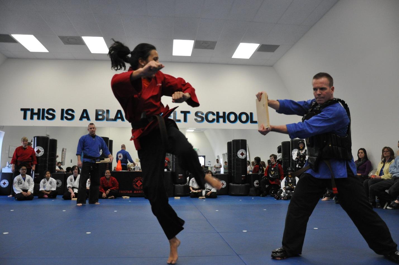 Natalya De La Cruz practices the board splitting skill.