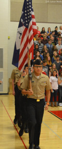 Dominick Nordin heads the NJROTC colorguard as they march out for the playing of the National Anthem.
