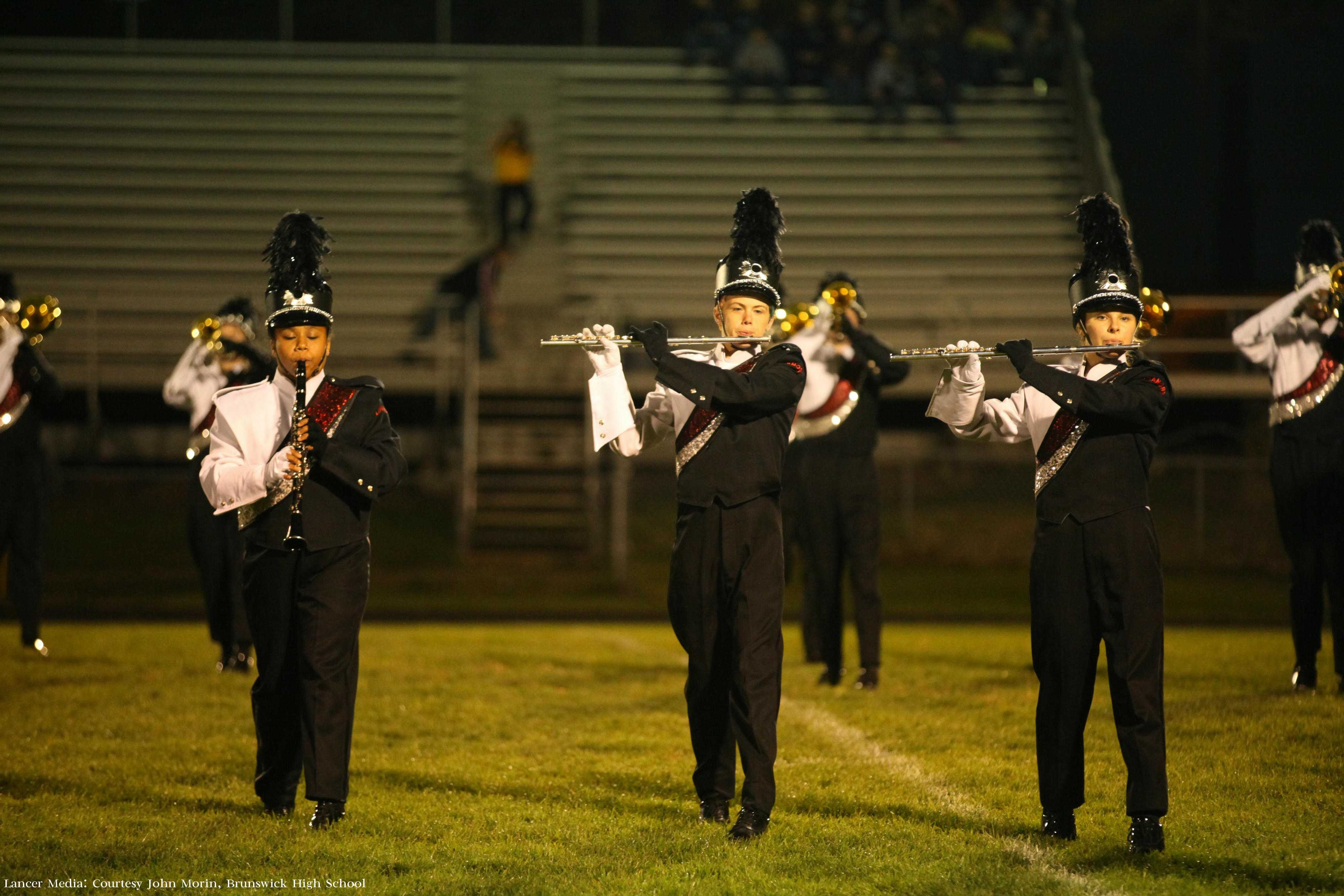 Breanna Wade, Kieth Kurtz, and Rebecca Yates march in the FCPS marching festival. Photo courtesy of John Morin, Brunswick High School