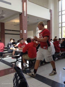 Lucas Hubbard, in his LHS Football jersey, participates in a lunchtime scavenger hunt competition.
