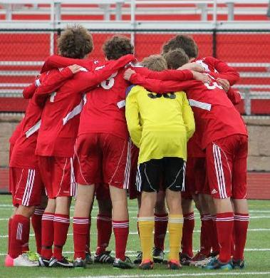 The boys varsity soccer team huddles up. Courtes of Linganore sports boosters.