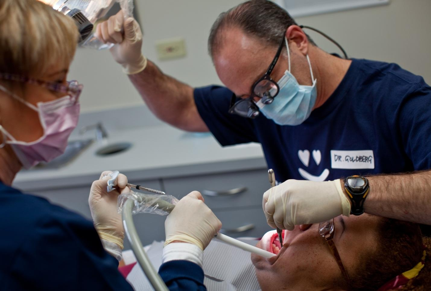 Photo courtesy of http://www.mctcampus.com/. Dr. Cary Goldberg and assistant Vonnie Poppell extract wisdom teeth from a patient  at the Center for Dental Excellence in Flossmoor, Illinois.