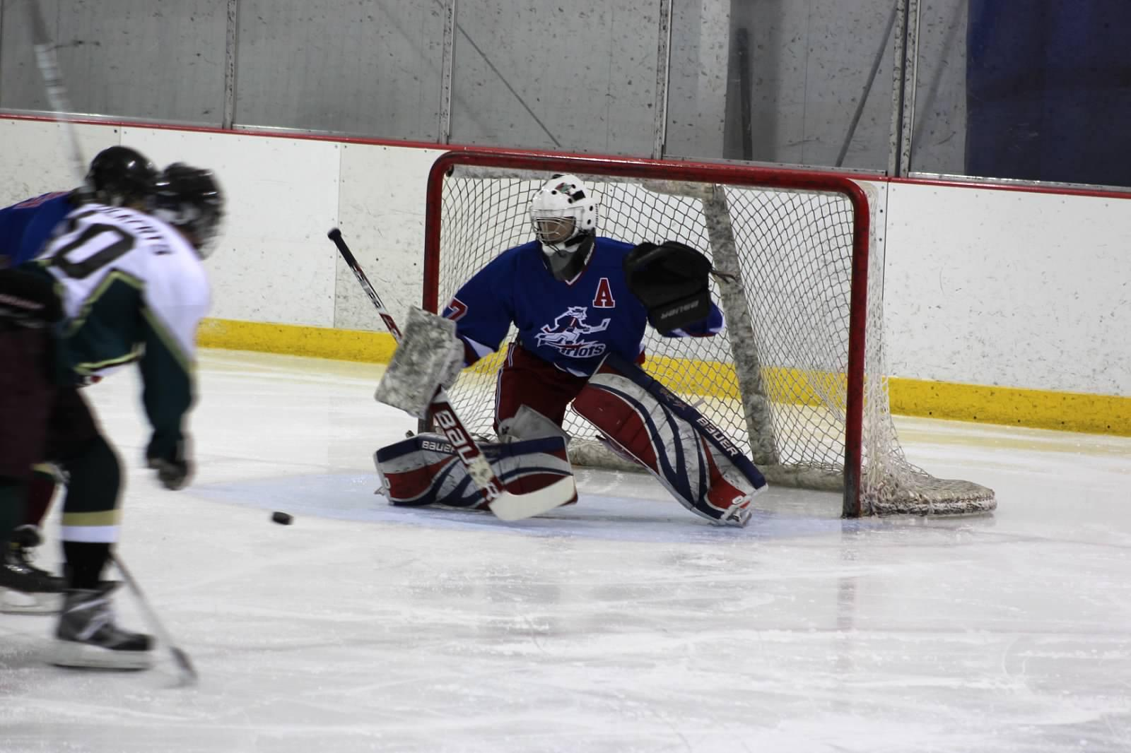 Linganore/TJ hockey goalie Devin Shields makes a pad save.  Courtesy of Mrs. Ericsson