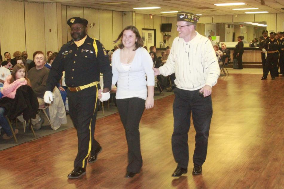 Abagayle Hilton is escorted by Alan Yetter  and an honor guard in Mount Airy VFW's center on January 26th, 2014
