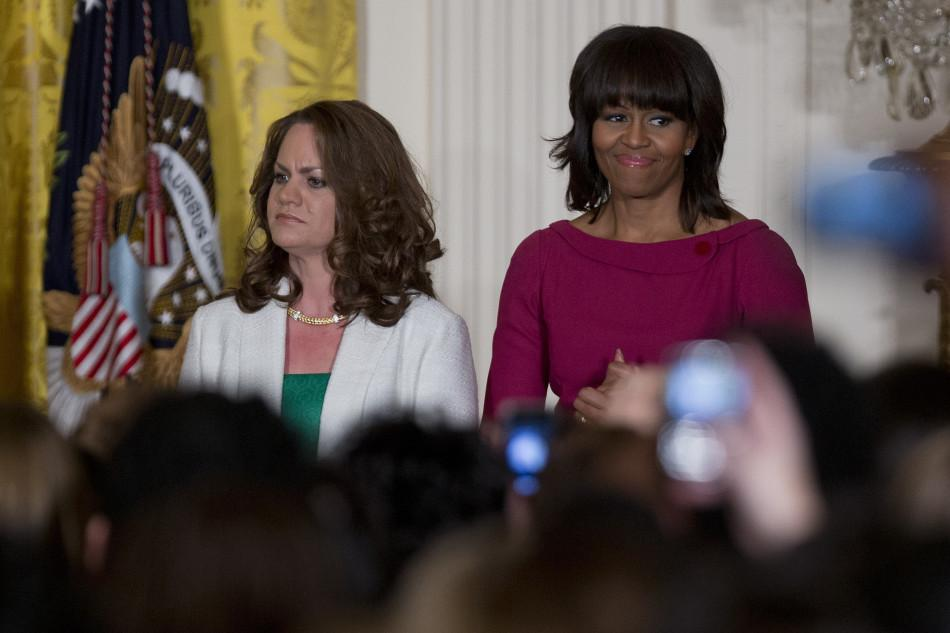 First lady Michelle Obama, right, stands with Amanda McMillan at the Women's History Month Reception in the East Room of the White House in Washington, D.C., on Monday, March 18, 2013. (Andrew Harrer/Bloomberg via Abaca Press/MCT)