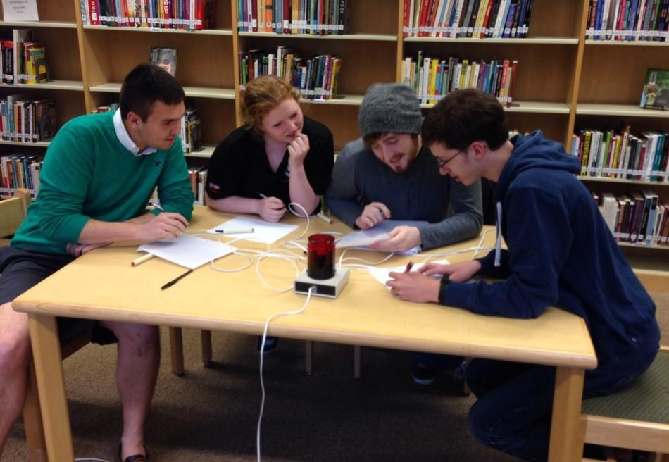 Members of the Academic Team confer over a word.