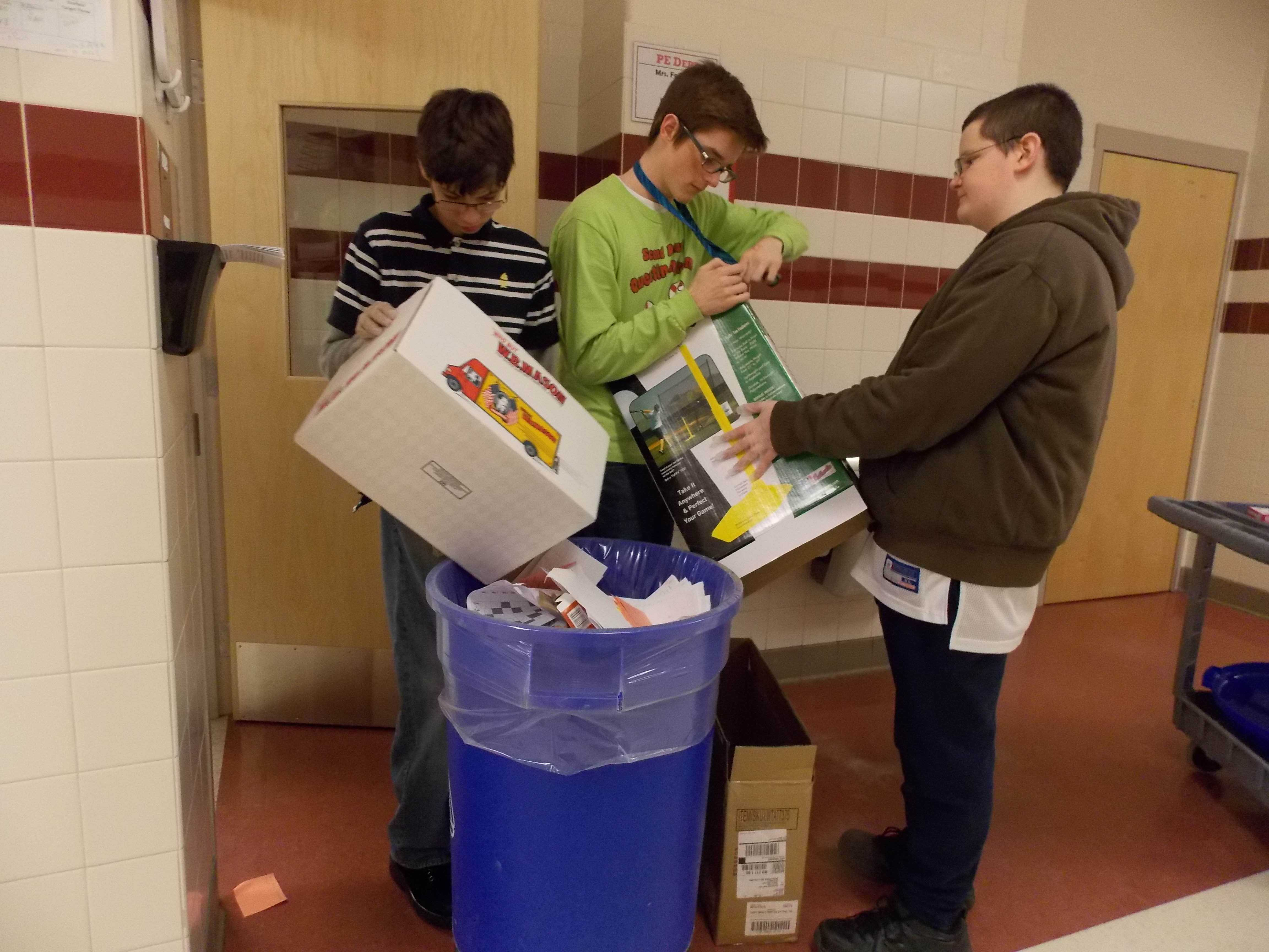 Owen Gamba, Jakob Connelly, and Mike Wilkerson collect recycling.