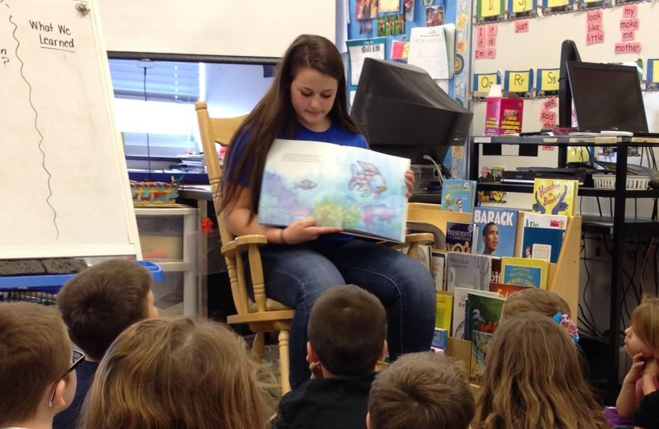 Sydney Giangulli reads to NMES first grade students as part of Read Across America Day.