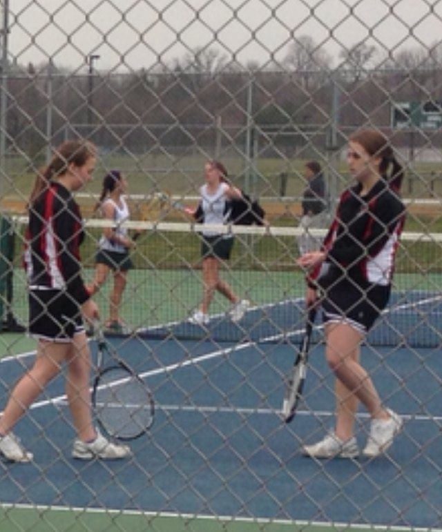 Sara and Caitiln Kubic playing second doubles against Tuscarora on Thursday.