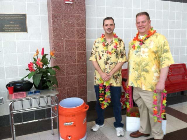 Darren Hornbeck and Dave Kehne greet staff members on Monday, 4-14.