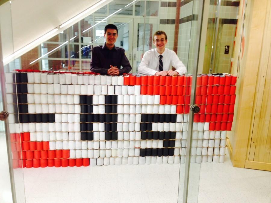 Sophomore students Noah Ismael and Jacob Butehorn smile for the camera after finishing the sculpture.