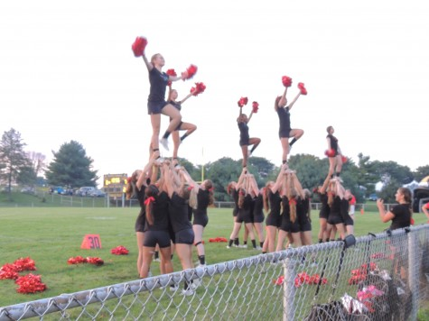 Cheerleaders and Poms pump up the crowd