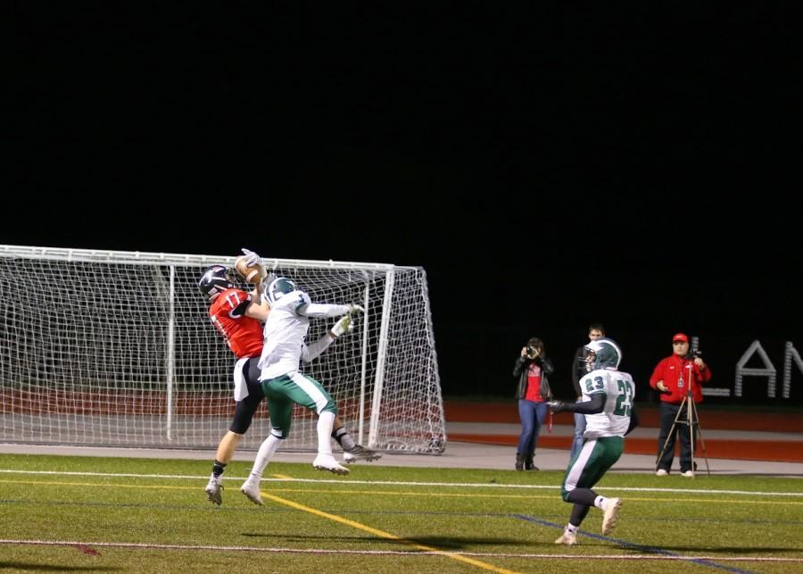 Senior Grant Waxter catches a touchdown pass against Tuscarora on Homecoming night.