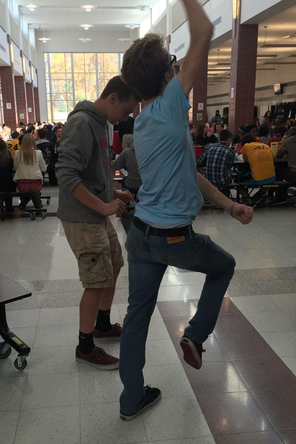 Senior Riley Bruning and Junior Jacob Butehorn dance in the cafeteria while facilitating mix it up day
