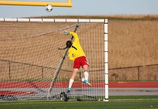 Senior goalie Rhianna Lapen makes a leaping save.