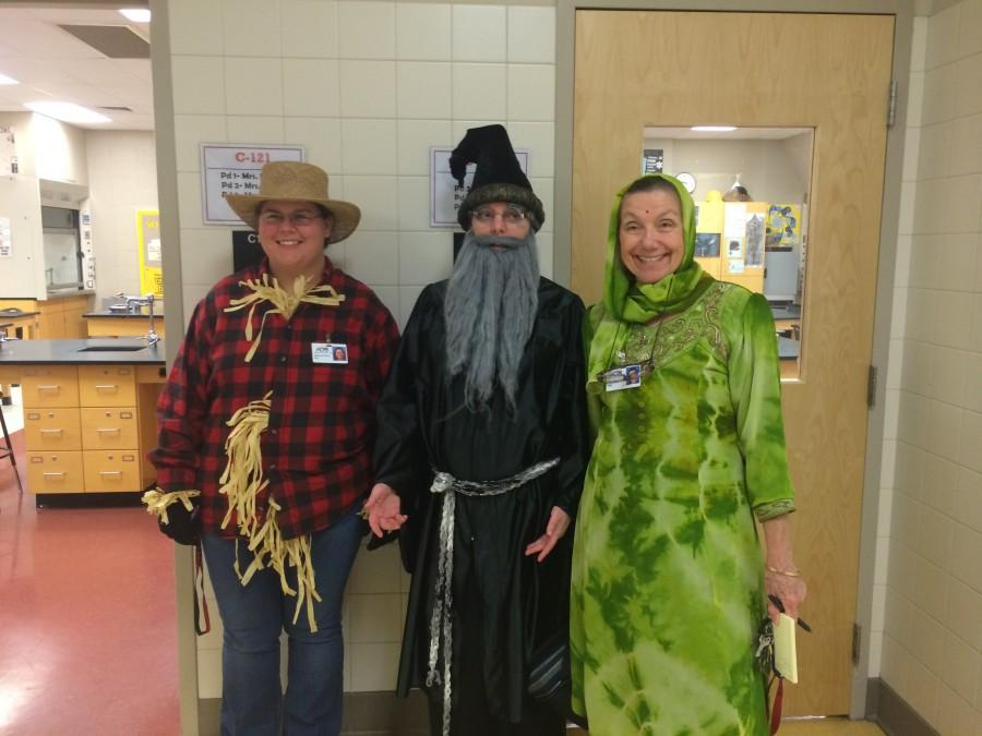 Science teachers Jessica Dillon, Beth Ericsson, and Ann Andrex dress up on Halloween. Ms. Dillon dressed as a Scarcrow, Mrs. Ericsson dressed as Aberforth (Dumbledore's brother), and Mrs. Andrex dressed as The Ghost of Indira Gandhi