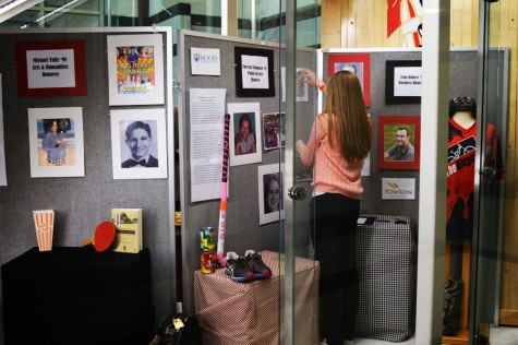 Photo of the day 11/18/14: Safsten sets up Distinguished Graduate display