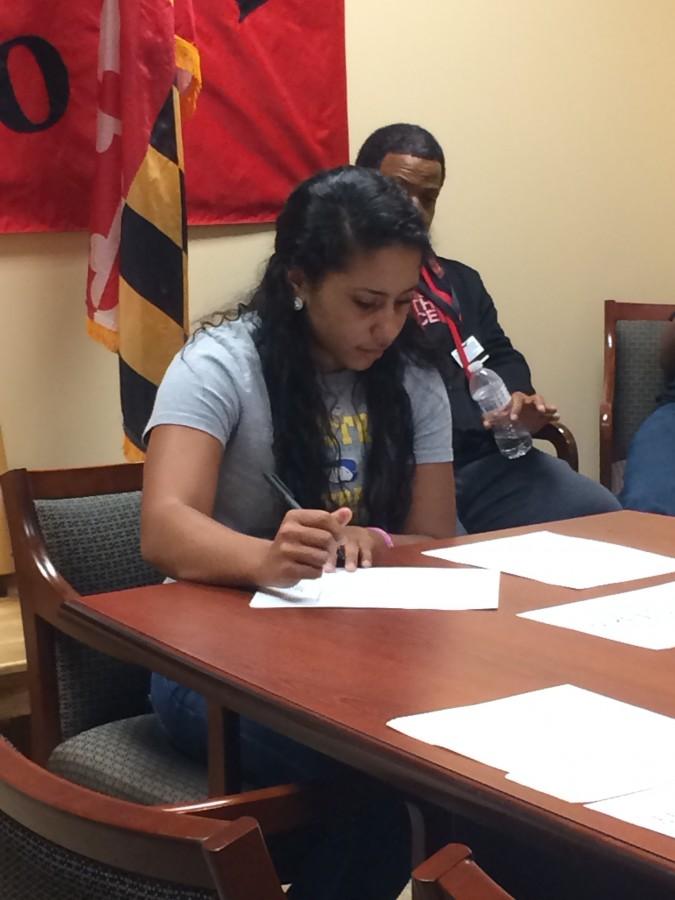 Senior Madi Ambush signs her Letter of Intent to Hofstra University.