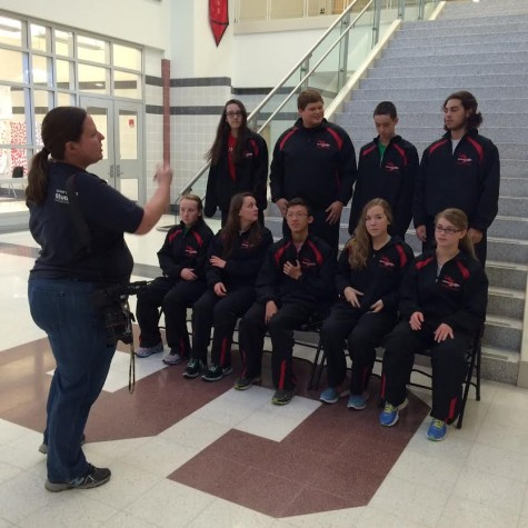 Swim team poses for a team photo: Photo of the Day 11/24/2014