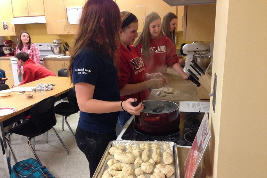 Senior Kaity Sheppard, Sophomores Shylo Arneson and Ashley Strahan, and Senior Taylor Strahan make their pretzels