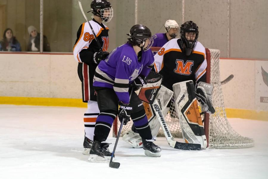 Sophomore forward Antonio Iocco sets up in front of the net against Middletown.