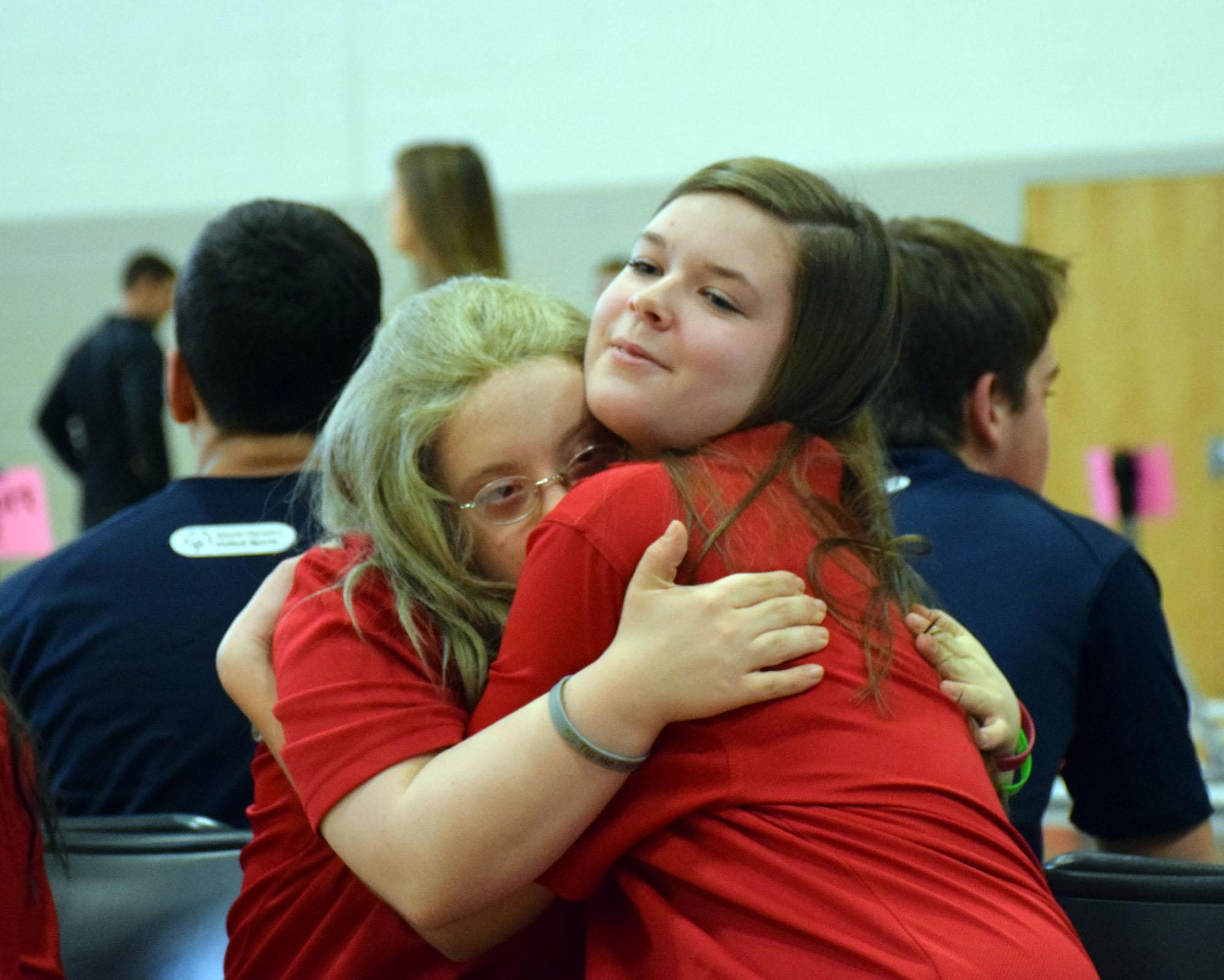 Sarah Webber (left) and Gabby Wolfe (right) share a hug after their tournament.