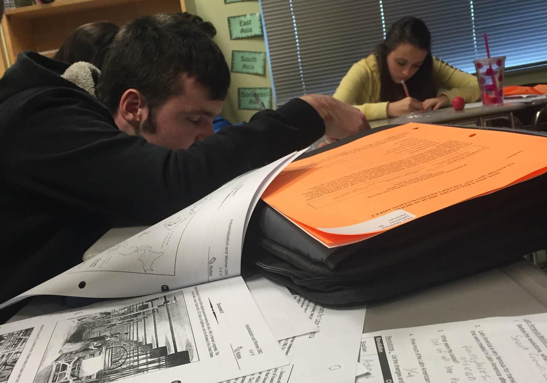 Paul Steves (left) and Faith Nelepa (right) work on a DBQ in Mrs. Richardson's  AP World class.