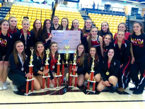 The Pom and Dance Team poses with their awards for several pictures after their State Competition.