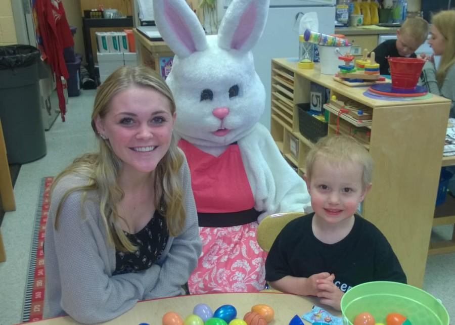 Carli Legambi and Conner pose with the Easter Bunny at the Little Lancers language table