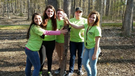 AP Environmental students (from left to right) Michelle Reina, Sara Combs, Ryan Stark, Abby Hilton, and Olivia DuBro pose for a picture in the Cunningham Falls State Park forest.