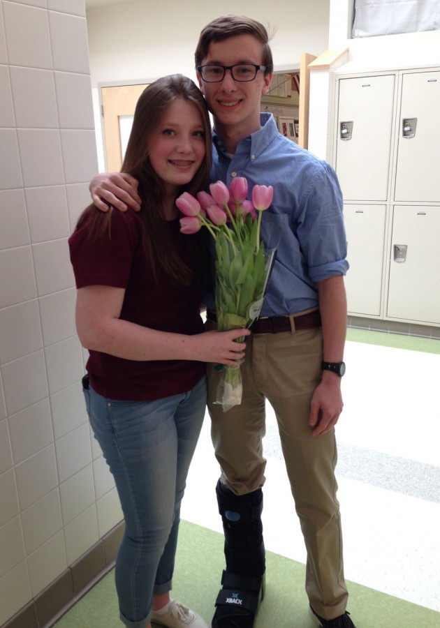 Alyssa Mattison poses with her prom date Brendan Mccann and her lovely tulips.
